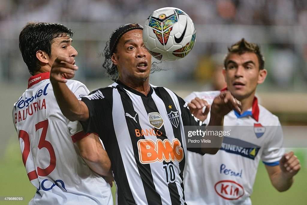 Fabian Balbuena of Nacional and <a gi-track='captionPersonalityLinkClicked' href=/galleries/search?phrase=Ronaldinho&family=editorial&specificpeople=202667 ng-click='$event.stopPropagation()'>Ronaldinho</a> Gaucho of Atletico during the match between Atletico MG v Nacional for the Copa Briedgestone Libertadores 2014 at Independencia Stadium on March 19, 2014 in Belo Horizonte, Brazil.