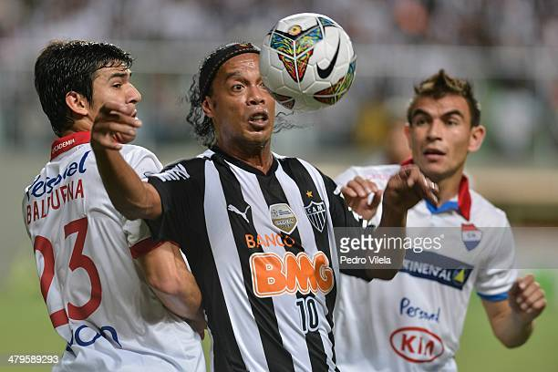 Fabian Balbuena of Nacional and Ronaldinho Gaucho of Atletico during the match between Atletico MG v Nacional for the Copa Briedgestone Libertadores...