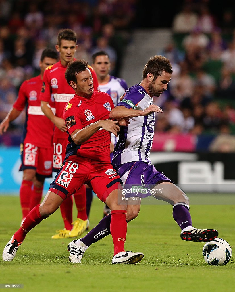 Fabian Barbiero of Adelaide and Dean Heffernan of the Glory contest for the ball during the round twenty seven A-League match between Perth Glory and Adelaide United at nib Stadium on March 30, 2013 in Perth, Australia.