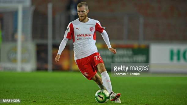 Fabian Baumgaertel of Halle runs with the ball during the 3 Liga match between Sportfreunde Lotte and Hallescher FC at Frimo Stadium on September 29...
