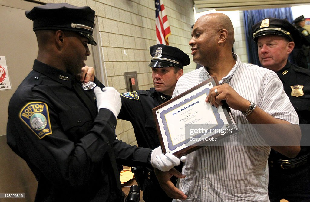 Fabian Belgrave, left, with his mentor, Larry Ellison, a Boston Police detective, following Belgrave's graduation from the Boston Police Academy.