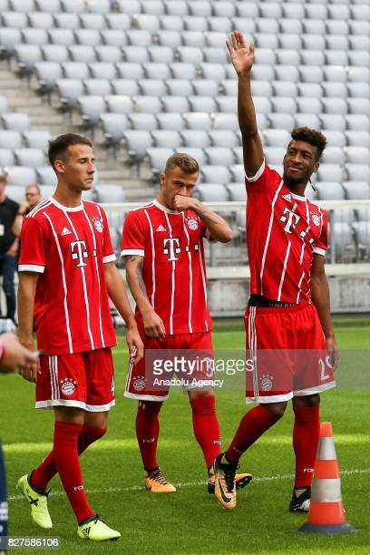 Fabian Benko Niklas Dorsch and Kingsley Coman of Bayern Munich arrive at Allianz Arena to pose for the team photo on August 08 2017 in Munich Germany
