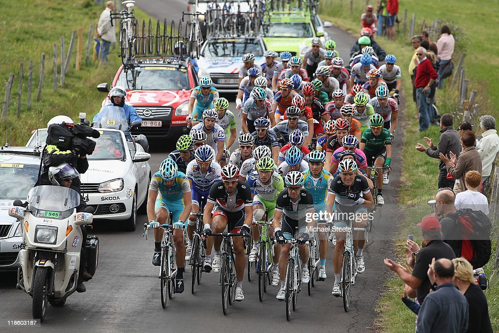 <a gi-track='captionPersonalityLinkClicked' href=/galleries/search?phrase=Fabian+Cancellara&family=editorial&specificpeople=573515 ng-click='$event.stopPropagation()'>Fabian Cancellara</a> (2L) of Switzerland and team Leopard Trek leads the chasing pack towards Col de la Croix Saint-Robert during Stage 8 of the 2011 Tour de France from Aigurande to Super-Besse Sancy on July 9, 2011 in Besse-sur-Braye, France.