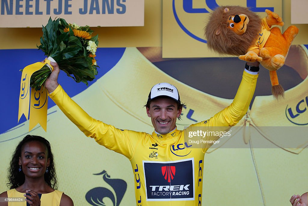 <a gi-track='captionPersonalityLinkClicked' href=/galleries/search?phrase=Fabian+Cancellara&family=editorial&specificpeople=573515 ng-click='$event.stopPropagation()'>Fabian Cancellara</a> of Switzerland and Trek Factory Racing celebrates as he is awarded the yellow jersey on the podium after stage two of the 2015 Tour de France, a 166km stage between Utrecht and Zelande, on July 5, 2015 in Zelande, Netherlands.