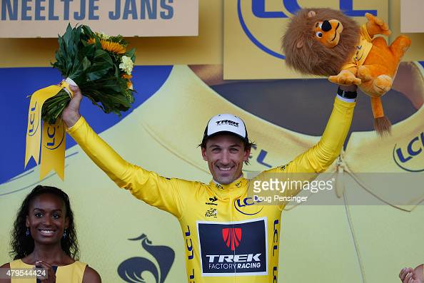 Fabian Cancellara of Switzerland and Trek Factory Racing celebrates as he is awarded the yellow jersey on the podium after stage two of the 2015 Tour...