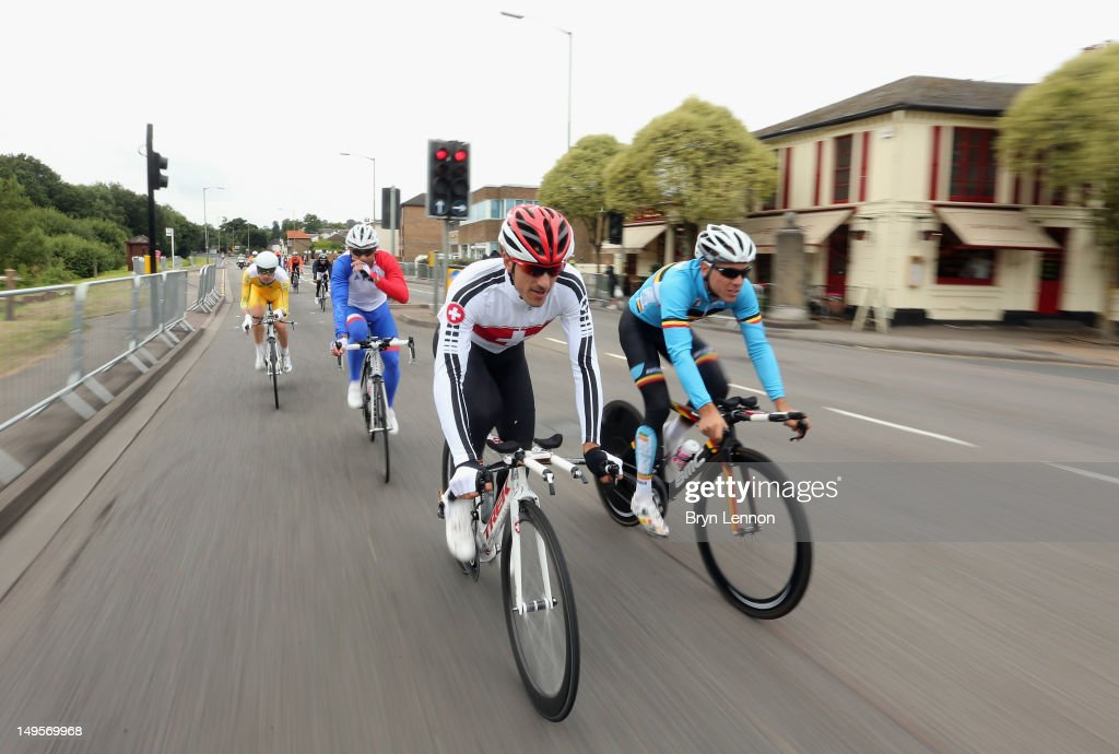 <a gi-track='captionPersonalityLinkClicked' href=/galleries/search?phrase=Fabian+Cancellara&family=editorial&specificpeople=573515 ng-click='$event.stopPropagation()'>Fabian Cancellara</a> (l) of Switzerland chats to <a gi-track='captionPersonalityLinkClicked' href=/galleries/search?phrase=Philippe+Gilbert&family=editorial&specificpeople=578487 ng-click='$event.stopPropagation()'>Philippe Gilbert</a> of Belgium during a police escorted recce of the Olympic Time trial course on Day 4 of the London 2012 Olympic Games in Hampton Court on July 31, 2012 in London, England.