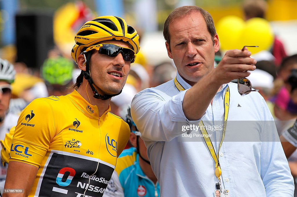 <a gi-track='captionPersonalityLinkClicked' href=/galleries/search?phrase=Fabian+Cancellara&family=editorial&specificpeople=573515 ng-click='$event.stopPropagation()'>Fabian Cancellara</a> of Switzerland riding for Radioshack-Nissan in the race leader's yellow jersey talks with <a gi-track='captionPersonalityLinkClicked' href=/galleries/search?phrase=Christian+Prudhomme&family=editorial&specificpeople=546988 ng-click='$event.stopPropagation()'>Christian Prudhomme</a>, Director of the Tour de France, prior to the start of stage four of the 2012 Tour de France from Abbeville to Rouen on July 4, 2012 in Abbeville, France.