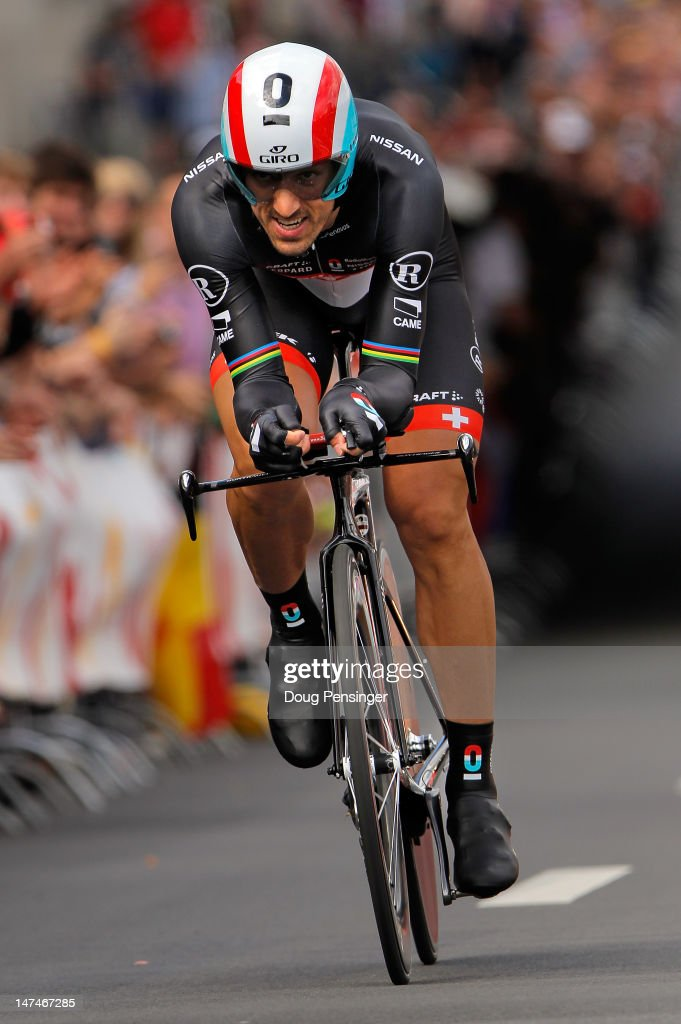 <a gi-track='captionPersonalityLinkClicked' href=/galleries/search?phrase=Fabian+Cancellara&family=editorial&specificpeople=573515 ng-click='$event.stopPropagation()'>Fabian Cancellara</a> of Switzerland riding for Radioshack-Nissan races to first place in the prologue of the 2012 Tour de France on June 30, 2012 in Liege, Belgium.