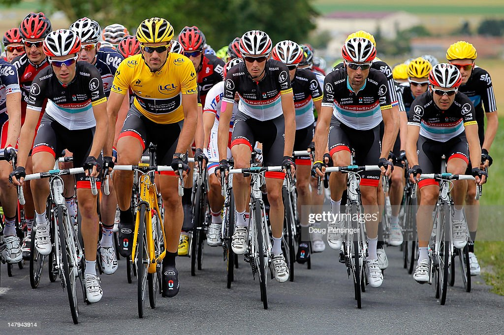 Fabian Cancellara of Switzerland riding for Radioshack-Nissan rides at the front of the peloton with the support of his teammates as he defended the race leader's yellow jersey during stage six of the 2012 Tour de France from Epernay to Metz on July 6, 2012 in Marson, France.