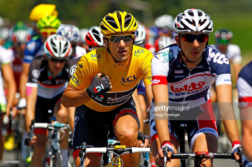 <a gi-track='captionPersonalityLinkClicked' href=/galleries/search?phrase=Fabian+Cancellara&family=editorial&specificpeople=573515 ng-click='$event.stopPropagation()'>Fabian Cancellara</a> of Switzerland riding for Radioshack-Nissan rides in the peloton as he defended the overall race leaders yellow jersey during stage two of the 2012 Tour de France from Vise to Tournai on July 2, 2012 in Tournai, Belgium.