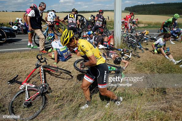 Fabian Cancellara of Switzerland riding for Trek Factory Racing in the overall race leader yellow jersey collects himself after being involved in a...
