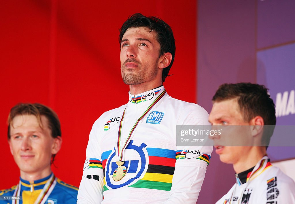 <a gi-track='captionPersonalityLinkClicked' href=/galleries/search?phrase=Fabian+Cancellara&family=editorial&specificpeople=573515 ng-click='$event.stopPropagation()'>Fabian Cancellara</a> of Switzerland stands on the podium with his gold medal after winning the Elite Men's Time Trial at the 2009 UCI Road World Championships on September 24, 2009 in Mendrisio, Switzerland.