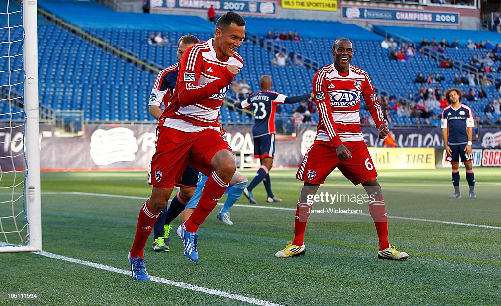 Fabian Castillo #7 of FC Dallas celebrates with teammate Jackson #6 of FC Dallas after scoring late in the second half against the New England Revolution during the game at Gillette Stadium on March 30, 2013 in Foxboro, Massachusetts.