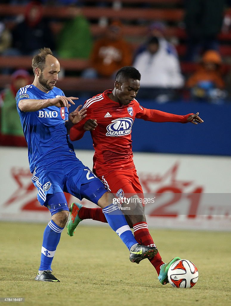 Fabian Castillo of FC Dallas defends the ball from Justin Mapp of Montreal Impact at Toyota Stadium on March 8 2014 in Frisco Texas
