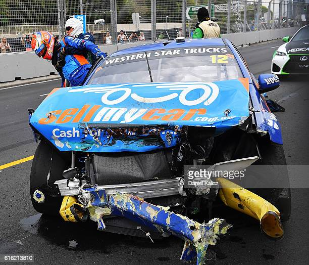 Fabian Coulthard driver of the DJR Team Penske Ford Falcon FGX is helped from his car by medical staff after having a collision with Garth Tander...