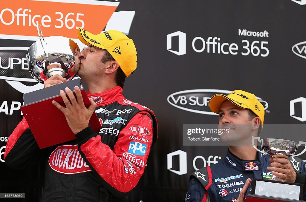 <a gi-track='captionPersonalityLinkClicked' href=/galleries/search?phrase=Fabian+Coulthard&family=editorial&specificpeople=678657 ng-click='$event.stopPropagation()'>Fabian Coulthard</a> driver of the #14 Lockwood Racing Holden celebrates after winning race three, as second place finisher <a gi-track='captionPersonalityLinkClicked' href=/galleries/search?phrase=Jamie+Whincup&family=editorial&specificpeople=678654 ng-click='$event.stopPropagation()'>Jamie Whincup</a> looks on at round two of the V8 Supercar Championship Series at Symmons Plains Raceway on April 6, 2013 in Launceston, Australia.
