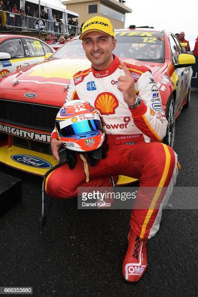 Fabian Coulthard driver of the Shell VPower Racing Team Ford Falcon FGX celebrates after winning race 4 for the Tasmania SuperSprint which is part of...