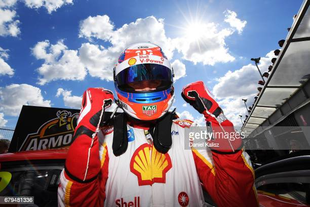 Fabian Coulthard driver of the Shell VPower Racing Team Ford Falcon FGX celebrates after taking pole position for race 7 during the Perth SuperSprint...