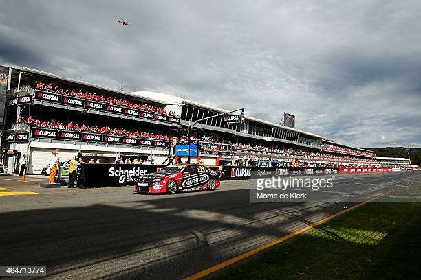 Fabian Coulthard drives the the Freightliner Racing Holden across the finish line to win race two of the V8 Supercars Clipsal 500 at Adelaide Street...