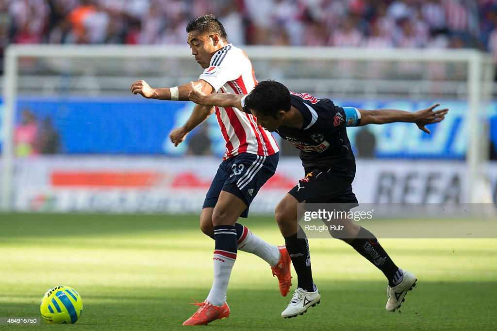 Fabian de la Mora of Chivas fights for the ball with Severo Meza of Monterrey during a match between Chivas and Monterrey as part of 8th round...