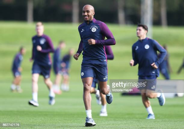 Fabian Delph laughs during training at Manchester City Football Academy on October 18 2017 in Manchester England