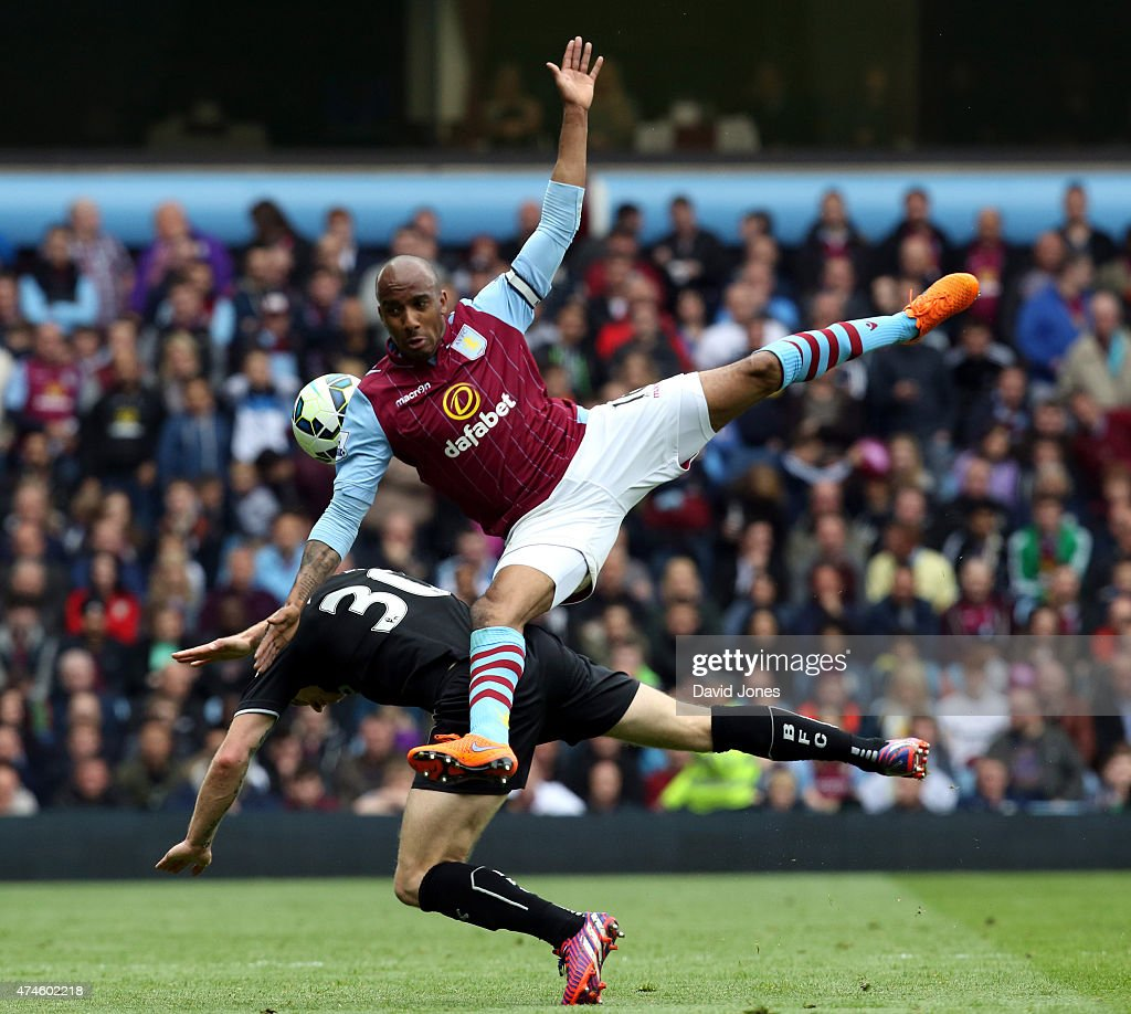 Fabian Delph of Aston Villa barges in to Ashley Barnes of Burnley during the Barclay's Premier League match at Villa Park on May 24, 2015 in Birmingham, England.