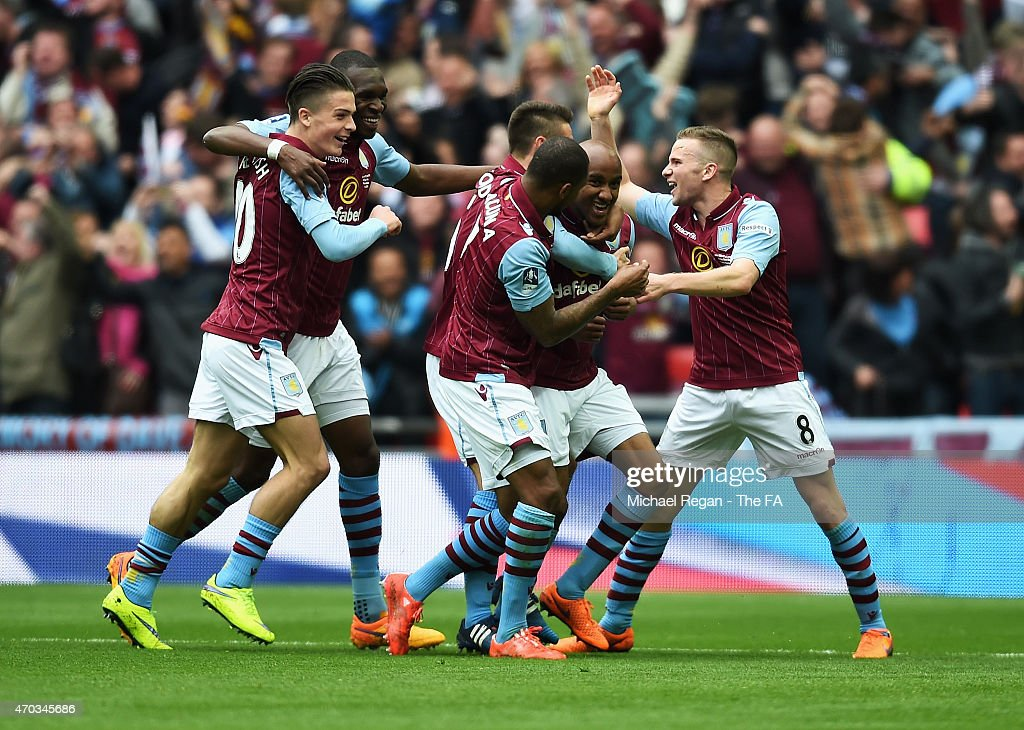 <a gi-track='captionPersonalityLinkClicked' href=/galleries/search?phrase=Fabian+Delph&family=editorial&specificpeople=5443479 ng-click='$event.stopPropagation()'>Fabian Delph</a> of Aston Villa celebrates scoring Aston Villa's 2nd goal with team-mates during the FA Cup Semi-Final match between Aston Villa and Liverpool at Wembley Stadium on April 19, 2015 in London, England.