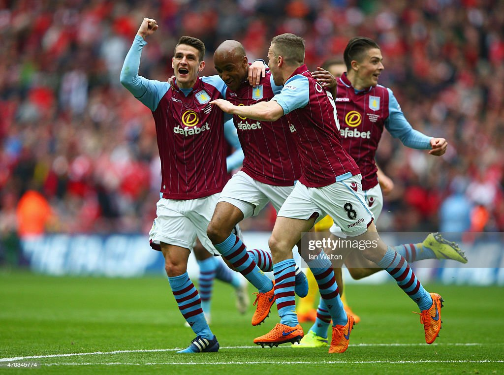 <a gi-track='captionPersonalityLinkClicked' href=/galleries/search?phrase=Fabian+Delph&family=editorial&specificpeople=5443479 ng-click='$event.stopPropagation()'>Fabian Delph</a> of Aston Villa (2L) celebrates scoring their second with <a gi-track='captionPersonalityLinkClicked' href=/galleries/search?phrase=Ashley+Westwood+-+Fu%C3%9Fballspieler+-+Jahrgang+1990&family=editorial&specificpeople=13491546 ng-click='$event.stopPropagation()'>Ashley Westwood</a>, <a gi-track='captionPersonalityLinkClicked' href=/galleries/search?phrase=Tom+Cleverley&family=editorial&specificpeople=4192565 ng-click='$event.stopPropagation()'>Tom Cleverley</a> of Aston Villa during the FA Cup Semi Final between Aston Villa and Liverpool at Wembley Stadium on April 19, 2015 in London, England.