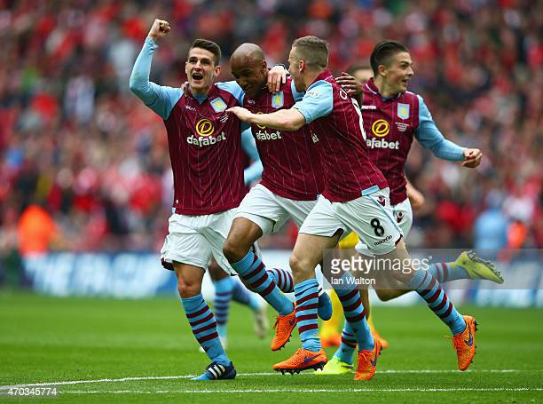 Fabian Delph of Aston Villa celebrates scoring their second with Ashley Westwood Tom Cleverley of Aston Villa during the FA Cup Semi Final between...