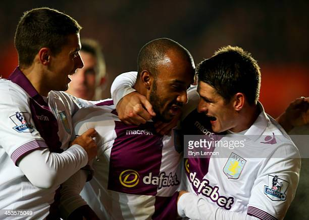 Fabian Delph of Aston Villa celebrates with team mates as he scores their third goal during the Barclays Premier League match between Southampton and...