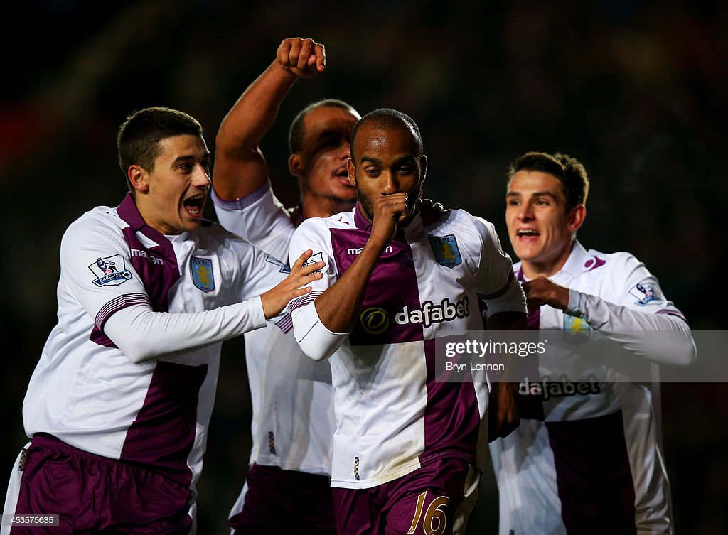 <a gi-track='captionPersonalityLinkClicked' href=/galleries/search?phrase=Fabian+Delph&family=editorial&specificpeople=5443479 ng-click='$event.stopPropagation()'>Fabian Delph</a> of Aston Villa (2R) celebrates with team mates <a gi-track='captionPersonalityLinkClicked' href=/galleries/search?phrase=Matthew+Lowton&family=editorial&specificpeople=8309591 ng-click='$event.stopPropagation()'>Matthew Lowton</a> (L), <a gi-track='captionPersonalityLinkClicked' href=/galleries/search?phrase=Gabriel+Agbonlahor&family=editorial&specificpeople=662025 ng-click='$event.stopPropagation()'>Gabriel Agbonlahor</a> (2L) and Ashley Westwood (R) as he scores their third goal during the Barclays Premier League match between Southampton and Aston Villa at St Mary's Stadium on December 4, 2013 in Southampton, England.