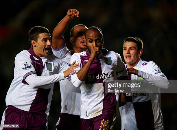 Fabian Delph of Aston Villa celebrates with team mates Matthew Lowton Gabriel Agbonlahor and Ashley Westwood as he scores their third goal during the...