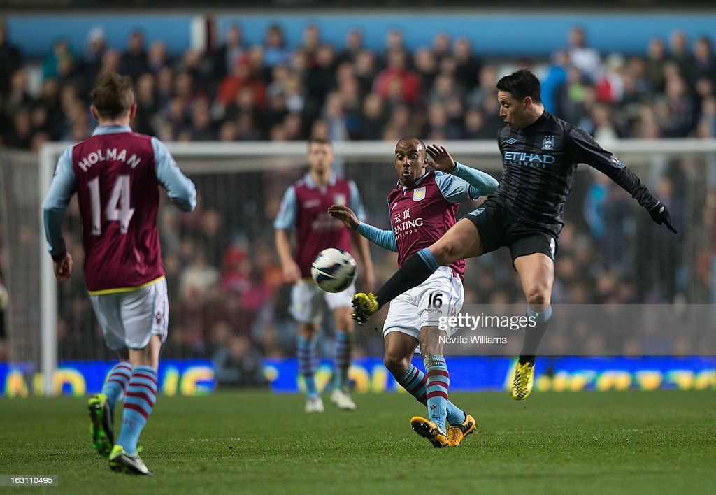 <a gi-track='captionPersonalityLinkClicked' href=/galleries/search?phrase=Fabian+Delph&family=editorial&specificpeople=5443479 ng-click='$event.stopPropagation()'>Fabian Delph</a> of Aston Villa is challenged by <a gi-track='captionPersonalityLinkClicked' href=/galleries/search?phrase=Samir+Nasri&family=editorial&specificpeople=648450 ng-click='$event.stopPropagation()'>Samir Nasri</a> of Manchester City during the Barclays Premier League match between Aston Villa and Manchester City at Villa Park on March 04, 2013 in Birmingham, England.