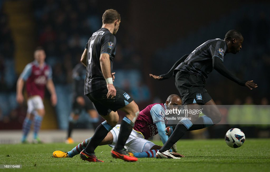 <a gi-track='captionPersonalityLinkClicked' href=/galleries/search?phrase=Fabian+Delph&family=editorial&specificpeople=5443479 ng-click='$event.stopPropagation()'>Fabian Delph</a> of Aston Villa is challenged by <a gi-track='captionPersonalityLinkClicked' href=/galleries/search?phrase=Yaya+Toure&family=editorial&specificpeople=550817 ng-click='$event.stopPropagation()'>Yaya Toure</a> of Manchester City during the Barclays Premier League match between Aston Villa and Manchester City at Villa Park on March 04, 2013 in Birmingham, England.