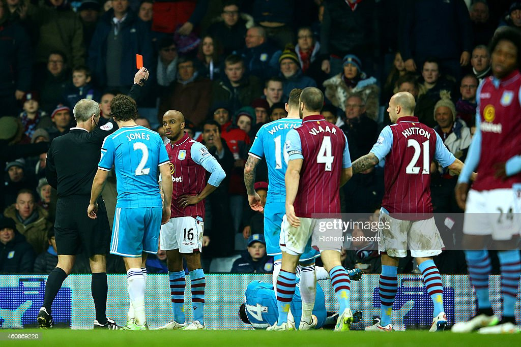 <a gi-track='captionPersonalityLinkClicked' href=/galleries/search?phrase=Fabian+Delph&family=editorial&specificpeople=5443479 ng-click='$event.stopPropagation()'>Fabian Delph</a> of Aston Villa receives a red card from referee <a gi-track='captionPersonalityLinkClicked' href=/galleries/search?phrase=Martin+Atkinson&family=editorial&specificpeople=703318 ng-click='$event.stopPropagation()'>Martin Atkinson</a> during the Barclays Premier League match between Aston Villa and Sunderland at Villa Park on December 28, 2014 in Birmingham, England.