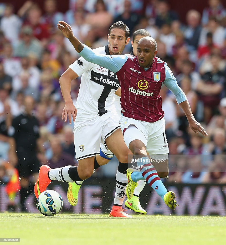 Fabian Delph of Aston Villa runs with the ball during the pre season friendly match between Aston Villa and Parma at Villa Park on August 9, 2014 in Birmingham, England.