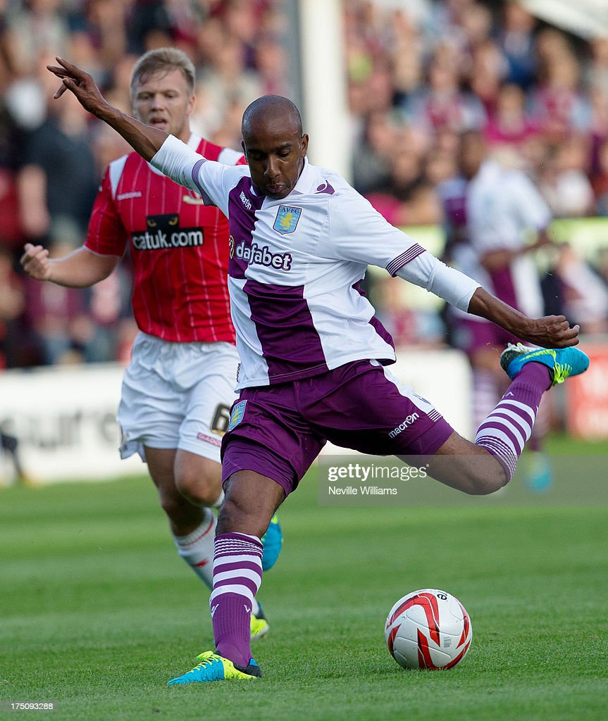<a gi-track='captionPersonalityLinkClicked' href=/galleries/search?phrase=Fabian+Delph&family=editorial&specificpeople=5443479 ng-click='$event.stopPropagation()'>Fabian Delph</a> of Aston Villa scores during the Pre Season Friendly match between Walsall and Aston Villa at Banks' Stadium on July 31, 2013 in Walsall, England.