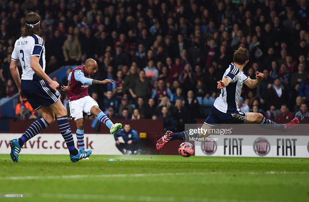 <a gi-track='captionPersonalityLinkClicked' href=/galleries/search?phrase=Fabian+Delph&family=editorial&specificpeople=5443479 ng-click='$event.stopPropagation()'>Fabian Delph</a> of Aston Villa shoots past Craig Dawson of West Bromwich Albion to score their first goal during the FA Cup Quarter Final match between Aston Villa and West Bromwich Albion at Villa Park on March 7, 2015 in Birmingham, England.