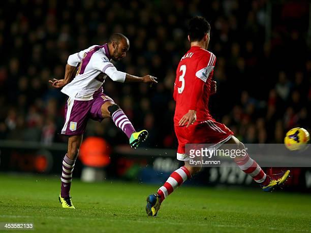 Fabian Delph of Aston Villa shoots past Maya Yoshida of Southampton to score their third goal during the Barclays Premier League match between...
