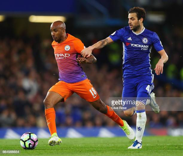 Fabian Delph of Manchester City and Cesc Fabregas of Chelsea battle for possession during the Premier League match between Chelsea and Manchester...