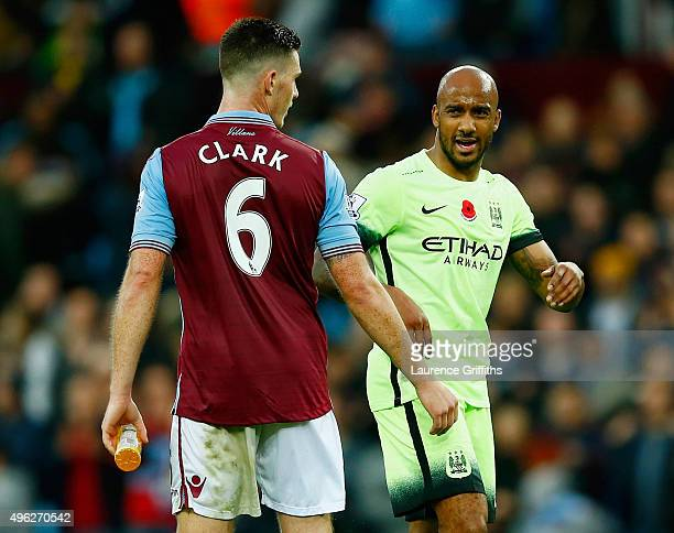 Fabian Delph of Manchester City and Ciaran Clark of Aston Villa exchange words following the Barclays Premier League match between Aston Villa and...