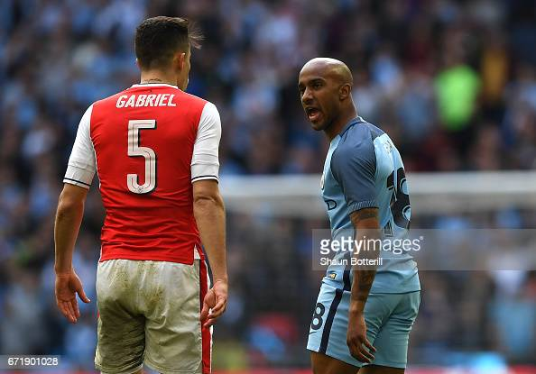 http://media.gettyimages.com/photos/fabian-delph-of-manchester-city-and-gabriel-of-arsenal-argue-during-picture-id671901028?s=594x594