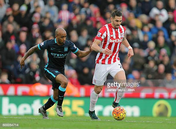 Fabian Delph of Manchester City and Geoff Cameron of Stoke City during the Barclays Premier League match between Stoke City and Manchester City at...