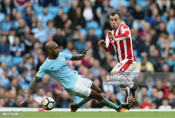 Fabian Delph of Manchester City and Xherdan Shaqiri of Stoke City during the Premier League match between Manchester City and Stoke City at Etihad...
