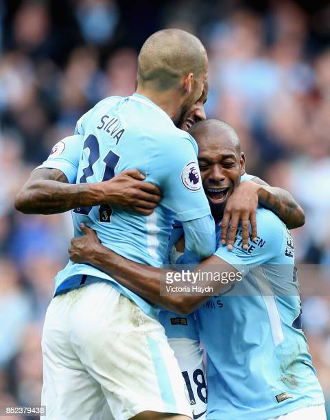 Fabian Delph of Manchester City celebrates scoring his side's fifth goal with his team mates David Silva and Fernandinho during the Premier League...