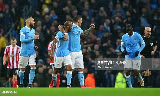 Fabian Delph of Manchester City celebrates scoring his team's second goal with his team mates during the Barclays Premier League match between...