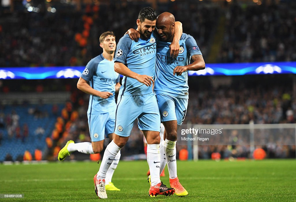 Fabian Delph (R) of Manchester City celebrates scoring the opening goal with Nolito during the UEFA Champions League Play-off Second Leg match between Manchester City and Steaua Bucharest at Etihad Stadium on August 24, 2016 in Manchester, England.