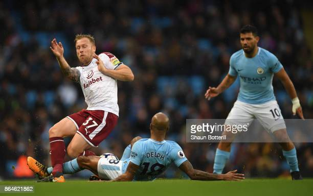 Fabian Delph of Manchester City challenges Scott Arfield of Burnley during the Premier League match between Manchester City and Burnley at Etihad...