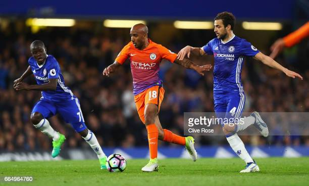 Fabian Delph of Manchester City holds off Cesc Fabregas of Chelsea during the Premier League match between Chelsea and Manchester City at Stamford...