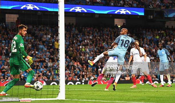 Fabian Delph of Manchester City scores the opening goal during the UEFA Champions League Playoff Second Leg match between Manchester City and Steaua...